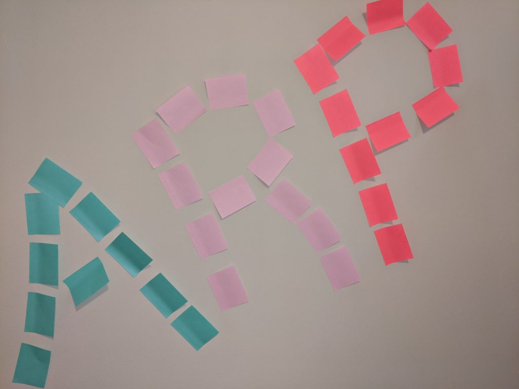 Letters ARP spelled out with post-it notes (stands for anti-racist pedagogy)